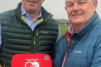 Tandragee Rovers youth teams donate defibrillator to town