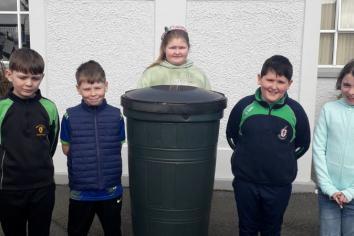Darkley Primary School pupils putting a new waterbutt to good use in garden